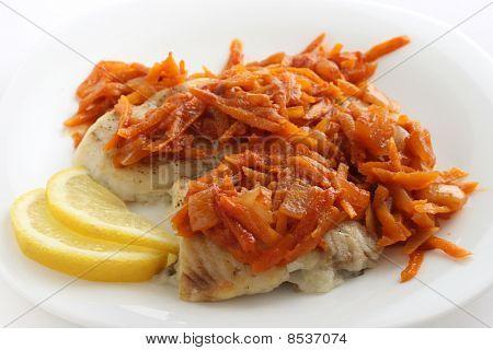 fried plaice with fried carrot and lemon