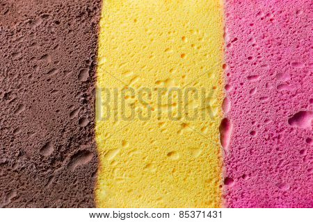 Colourful Neapolitan ice cream background and texture