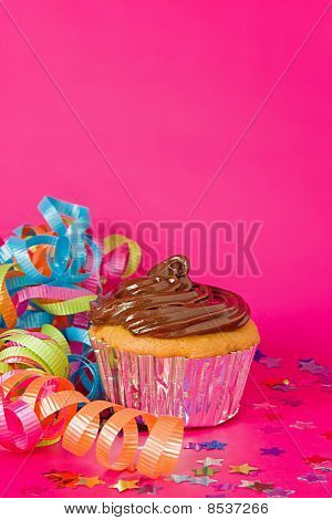 Single cupcake for a celebration on blue background