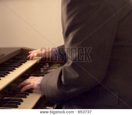 musician playing hammond organ