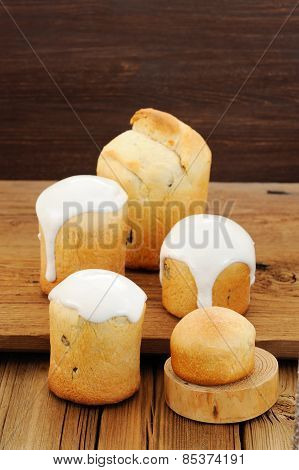 Kulichi, Traditional Russian Easter Cake With Icing On Wooden Background