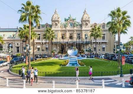 MONTE CARLO, MONACO - OCTOBER 3, 2014: Monte Carlo Casino in Monaco with Sky Mirror sculpture by Anish Kapoor in front