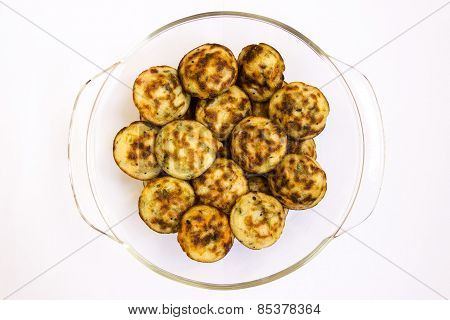 Indian cuisine ~ fried puffed balls made from mould filled with dough of rice powder, chopped onions