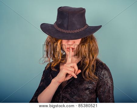 Young Woman With Finger On Her Lips