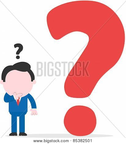 Confused Businessman Beside Big Question Mark