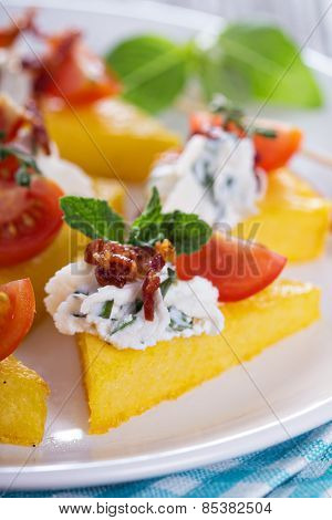 Polenta appetizers with ricotta and bacon
