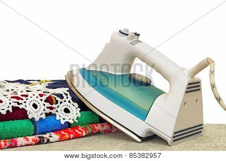Electric Iron On A White Background.