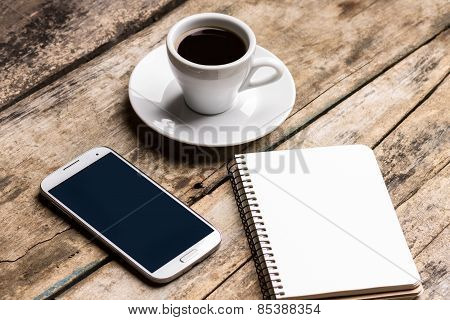 Mock Up Set Of Smartphone, Notebook And Cup Of Coffee.