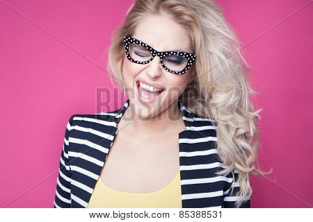 Successful young attractive winking laughing woman wearing glasses