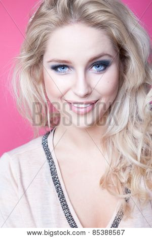 Young attractive smiling  blonde woman expressive portrait beauty concept