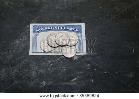 Social security card with coins on it