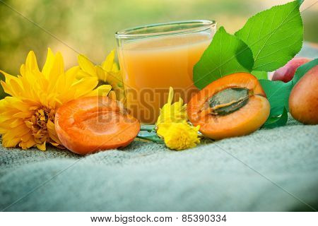 Glass of apricot juice and apricots