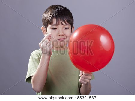 Boy Going To Pop Balloon.