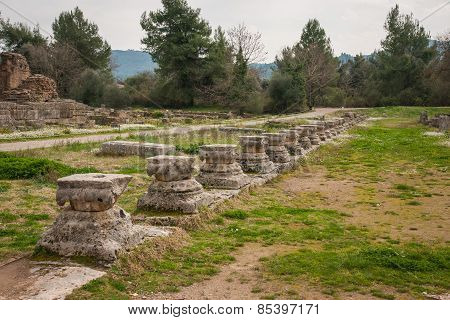 Ancient Greek Ruins At The Archaeological Place Of Ancient Olimpia