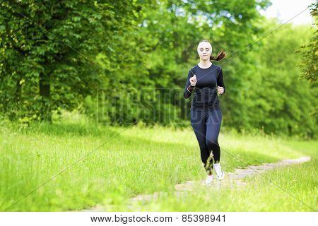 Happy Smiling Caucasian Sportwoman Having Her Regular Training Outdoors