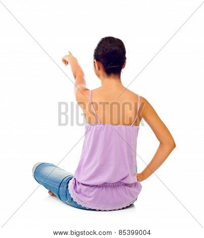Sitting Teen Girl While Pointing With Her Finger