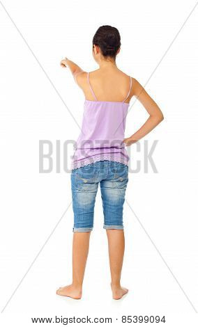 Teen Girl With Blue Jeans And Tank Top While Pointing With Her Finger
