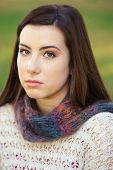 foto of stare  - Single serious female teenager in sweater staring - JPG
