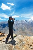 stock photo of himachal pradesh  - Photographer tourist make photo of scenic india himalayas mountains spiti valley landscape of himachal pradesh - JPG