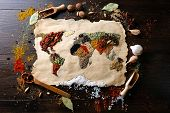 stock photo of kindness  - Map of world made from different kinds of spices on wooden background - JPG