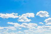 stock photo of cumulus-clouds  - Cumulus clouds blue sky and sun  - JPG