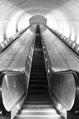foto of escalator  - Black and white photo of an empty escalator at a metro station in Washington, DC.