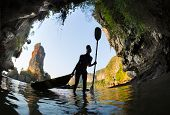 pic of cave woman  - Silhouette of the young lady entering marine cave with kayak - JPG