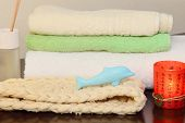 stock photo of bast  - Towel stack bast and soap in the form of a dolphin taken closeup - JPG