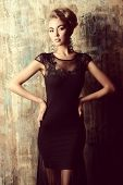 stock photo of slim model  - Stunning female model in black evening dress - JPG