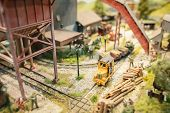 image of railroad yard  - closeup of a miniature model railway lumber yard - JPG
