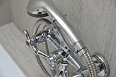 picture of tapping  - chrome faucet in bathroom with separate taps and showerhead - JPG