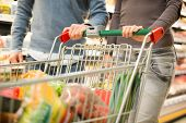 picture of supermarket  - Detail of a couple shopping in a supermarket - JPG