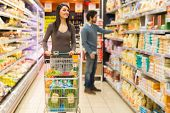 pic of grocery cart  - Young couple shopping in a supermarket - JPG