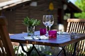 stock photo of chalet  - Table set on the terrace of a French restaurant - JPG