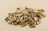 image of cardamom  - Dry Cardamom heap on the wood background - JPG