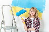 stock photo of wall painting  - Happy woman makes repairs at home  - JPG