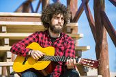 stock photo of afro hair  - Guitarist with plaid shirt and afro hair - JPG