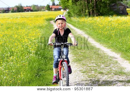 Girl Going By Bike