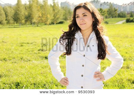 Young Confident Brunette In Park