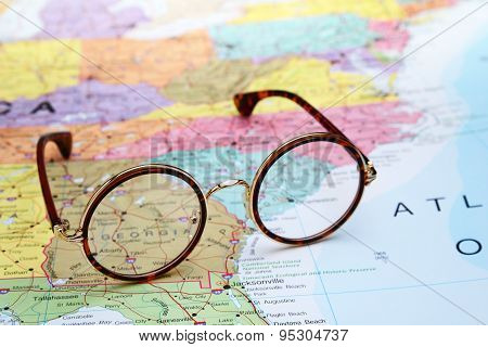 Glasses on a map of USA - Georgia