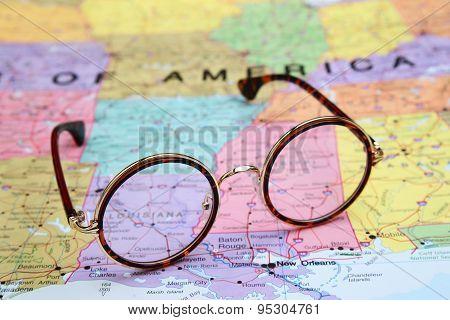 Glasses on a map of USA - Louisiana