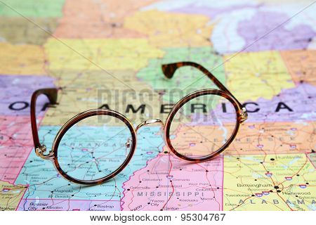 Glasses on a map of USA - Arkansas