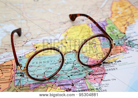 Glasses on a map of USA - Pennsylvania