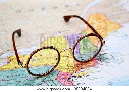 Glasses on a map of USA - New York
