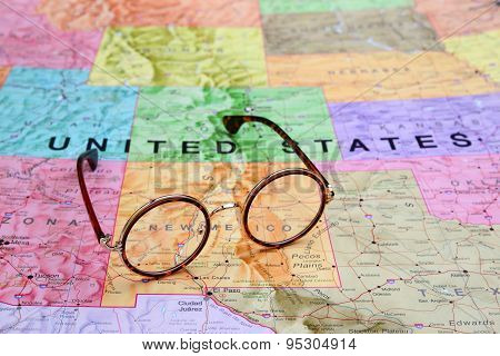 Glasses on a map of USA - New Mexico