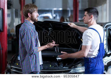 Man Giving Motor Mechanic Key