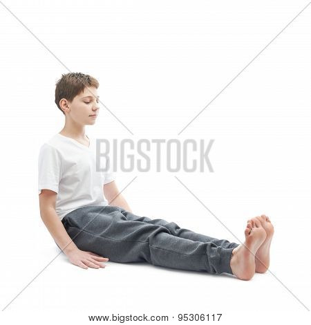 Young boy stretching or doing yoga