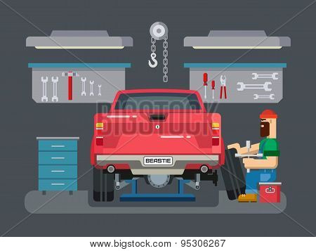 Mechanic Repairs Car in the Garage