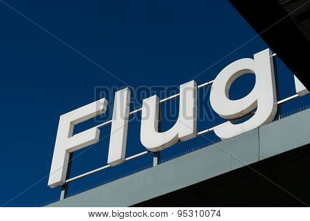 'flug' Sign On Rooftop With Blue Sky Background