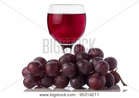 Red Wine In Glass And Grapes